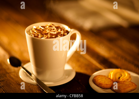 Hot Chocolate with Whipped Cream and Cookies - Stock Photo