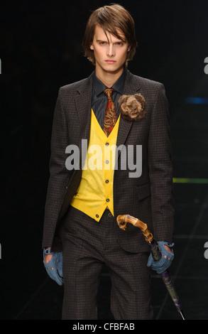 Burberry Milan Menswear Ready to Wear Autumn Winter Menswear flirt femininity on the catwalks of Milan Checked suit - Stock Photo