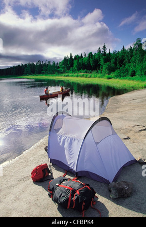 Father and son canoeing on the Whiteshell River, Whiteshell Provincial Park, Manitoba, Canada - Stock Photo