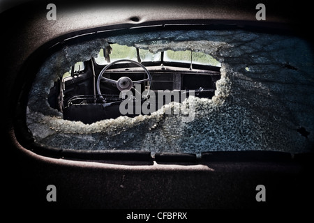 View though old Chevy's smashed rear window, Saskatchewan, Canada - Stock Photo
