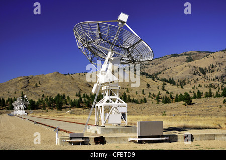 One large satellite dish with three in the background at the Dominion Radio Astrophysical Observatory near Okanagan - Stock Photo