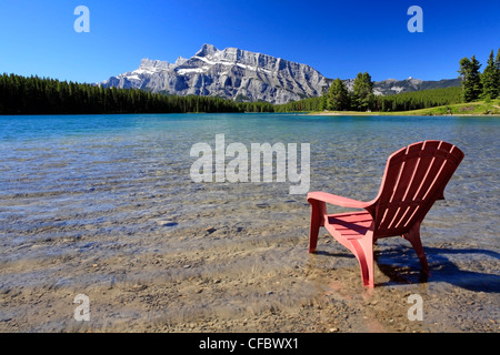 Deck chair at Two Jack Lake, Banff National Park, Alberta, Canada - Stock Photo