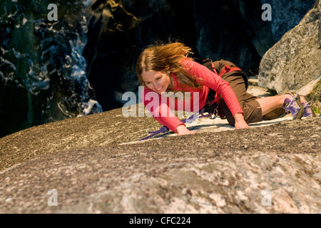 female rock climber ascends route Stillwater - Stock Photo