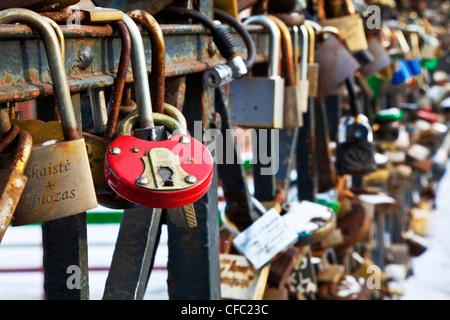 Love padlocks attached to a bridge across to the Užupis area of Vilnius, Lithuania - Stock Photo