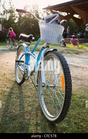 Cruiser bicycle with basket parked on kickstand. Victoria Beach, Manitoba, Canada. - Stock Photo