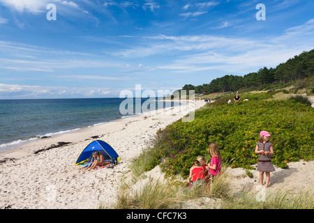 Children on Baltic Sea beach, Hasle, Bornholm, Denmark - Stock Photo