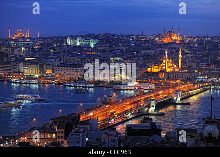 View over Golden Horn with Galata Bridge in the evening, Istanbul, Turkey - Stock Photo
