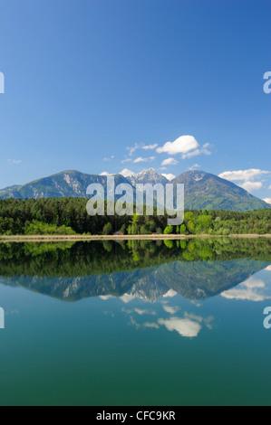 Karawanken range reflecting in lake Turnersee, lake Turnersee, Carinthia, Austria, Europe - Stock Photo