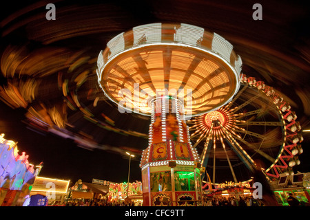 Swing carousel and ferris wheel at the Oktoberfest at night, Theresienwiese, Munich, Bavaria, Germany, Europe, Europe - Stock Photo