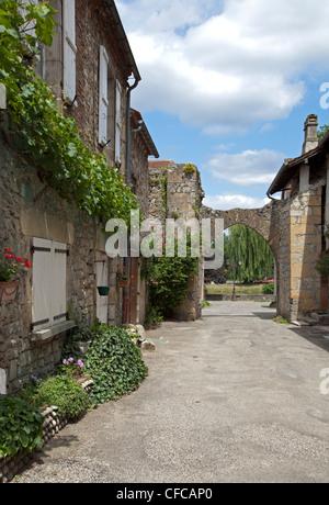 Medieval Gate, rue de la Guierle in Bretenoux - Stock Photo