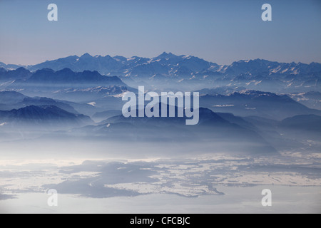 Aerial photo of northern Chiemsee in winter, view south towards the Chiemgau and Austrian Alps, Bavaria, Germany - Stock Photo