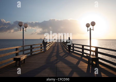 Couple on the pier, Binz seaside resort, Ruegen island, Baltic Sea, Mecklenburg-West Pomerania, Germany - Stock Photo