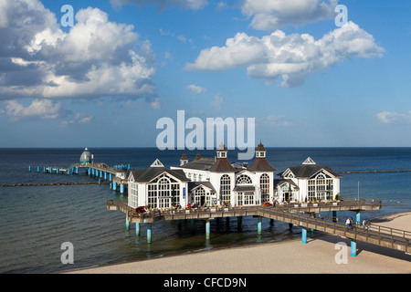 Clouds over the pier and beach, Sellin seaside resort, Ruegen island, Baltic Sea, Mecklenburg-West Pomerania, Germany - Stock Photo