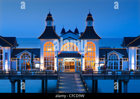 Illuminated pier in the evening, Sellin seaside resort, Ruegen island, Baltic Sea, Mecklenburg-West Pomerania, Germany - Stock Photo