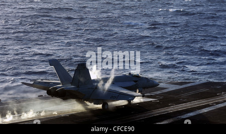 ARABIAN SEA (March 5, 2012) An F/A-18E Super Hornet assigned to the Kestrels of Strike Fighter Squadron (VFA) 137 - Stock Photo