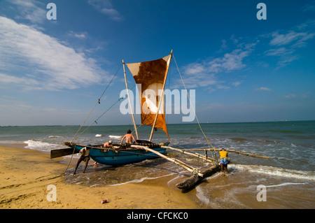 A beautiful catamaran boat with tourist on board set to sail the sea. - Stock Photo