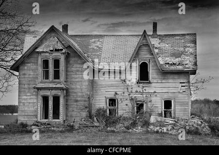An old abandoned derelict building house in a winter for Building a house in ontario