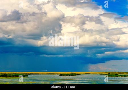 Rainstorm over prairie near Medecine Hat, Alberta, Canada - Stock Photo