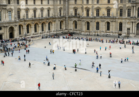 Looking down on visitors queuing in the courtyard of the Louvre Museum in Paris, France. - Stock Photo