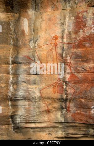 Aboriginal paintings in rock shelter in quartzite cliff, Ubirr Rocks, Kakadu National Park, Northern Territory, - Stock Photo
