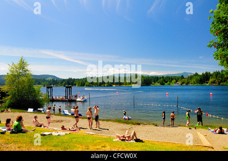 People enjoying boating and the beach at the Government Wharf on Shawnigan Lake, British Columbia, Canada. - Stock Photo