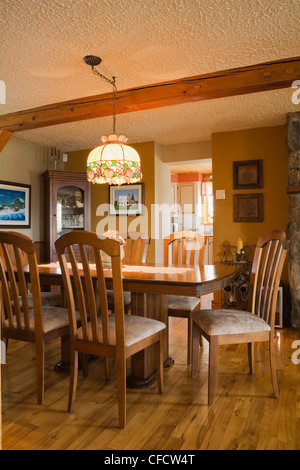 Dining Room Inside A Canadiana Cottage Style Residential Stacked Stock Photo