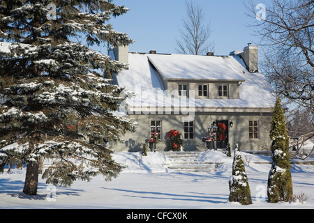 Residential home with Christmas decorations in winter, Quebec, Canada. - Stock Photo
