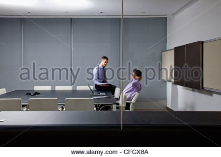 Businessmen talking in conference room - Stock Photo