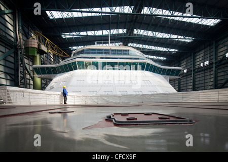 Cruiser under construction in dry dock, Meyer Werft, Papenburg, Lower Saxony, Germany - Stock Photo