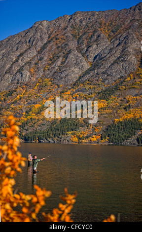 Fishermen in Tagish Lake, Yukon, Canada. - Stock Photo