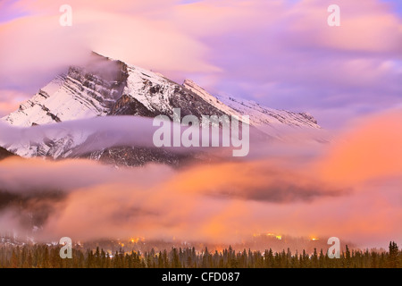 Mount Rundle, Banff townsite at dusk and dramatic clouds. Banff National Park, Alberta, Canada. - Stock Photo