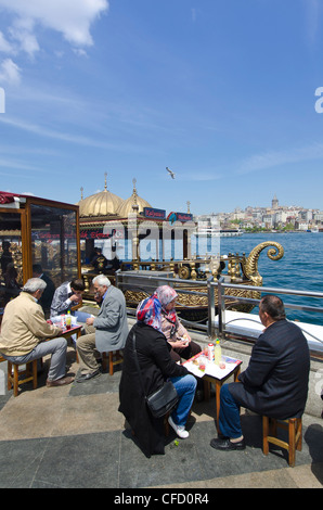 Floating restaurants on the Golden Horn by the Galata Bridge, located in the Eminönü district of Istanbul, Turkey. - Stock Photo