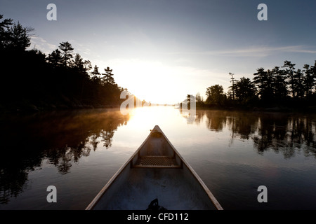Bow of a canoe on the French River at dawn in French River Provincial Park, Ontario, Canada - Stock Photo
