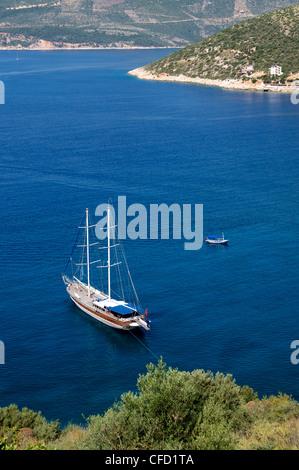 Gullet anchored at Kalkan, a popular tourist resort, Antalya Province, Anatolia, Turkey, Asia Minor, Eurasia - Stock Photo