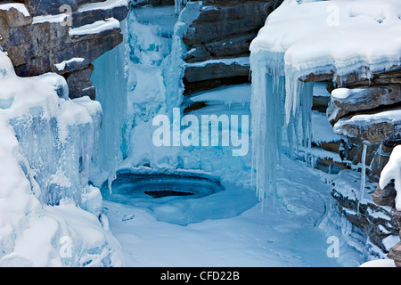 Ice formations AthabascFalls during winter - Stock Photo