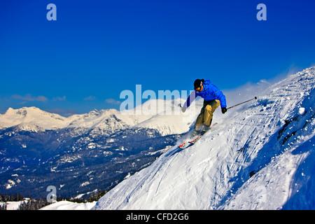Skier on the upper slopes of Whistler Mountain, Whistler Blackcomb, Whistler, British Columbia, Canada. - Stock Photo