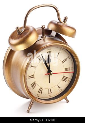 Alarm clock isolated on white background.It's five minutes to twelve p.m. - Stock Photo