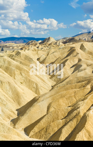 Siltstone eroded formations of Zabriske Point, Furnace Creek, Death Valley National Park, California, United States - Stock Photo