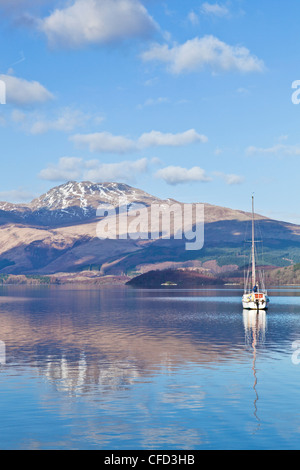 Loch Lomond with sailing boat, snow covered Beinn Uird behind, from Luss Jetty, Luss, Argyll and Bute, Scotland, - Stock Photo