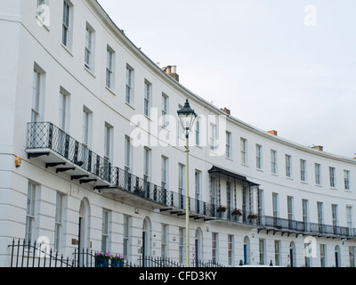 A section of the Regency architecture terraced houses which make up Royal Crescent, Cheltenham. - Stock Photo