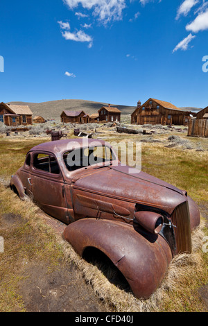 Old rusty American car in the California gold mining ghost town, Bodie State Historic Park, Bridgeport, California, - Stock Photo