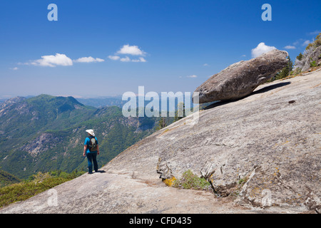 Tourist hiker, at Hanging rock, Tulare County, Sequoia National Park, Sierra Nevada, California, USA - Stock Photo
