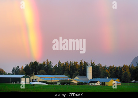A double rainbow over a farm in Cowichan Bay, British Columbia, Canada. - Stock Photo