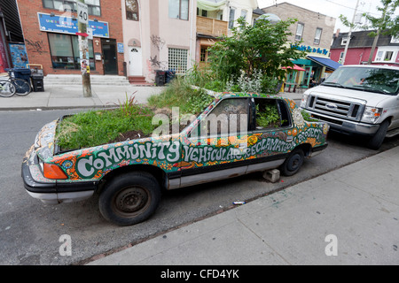 junkyard car that been turned into curb-side - Stock Photo