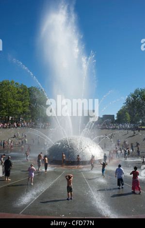 Children play in the Seattle Center Fountain on a hot summer day, Seattle, Washington State, United States of America - Stock Photo