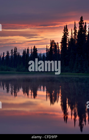 Sunset at an unnamed lake near Salmo Lake, Alaska Highway, Yukon Territory, Canada, - Stock Photo