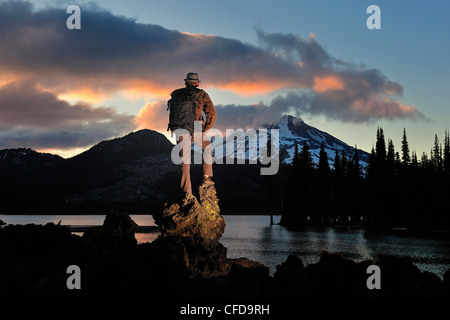 Man with backpack hiking, Sparks Lake, Oregon. - Stock Photo