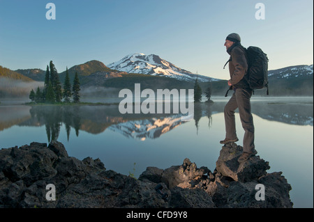 Man with backpack hiking, Sparks Lake in the morning. - Stock Photo
