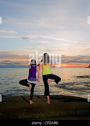 mother daughter spend beautiful sunset practicing - Stock Photo