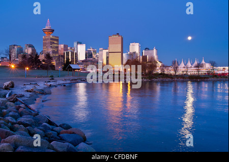 Full moon setting over Canada Place, Vancouver, British Columbia, Canada - Stock Photo